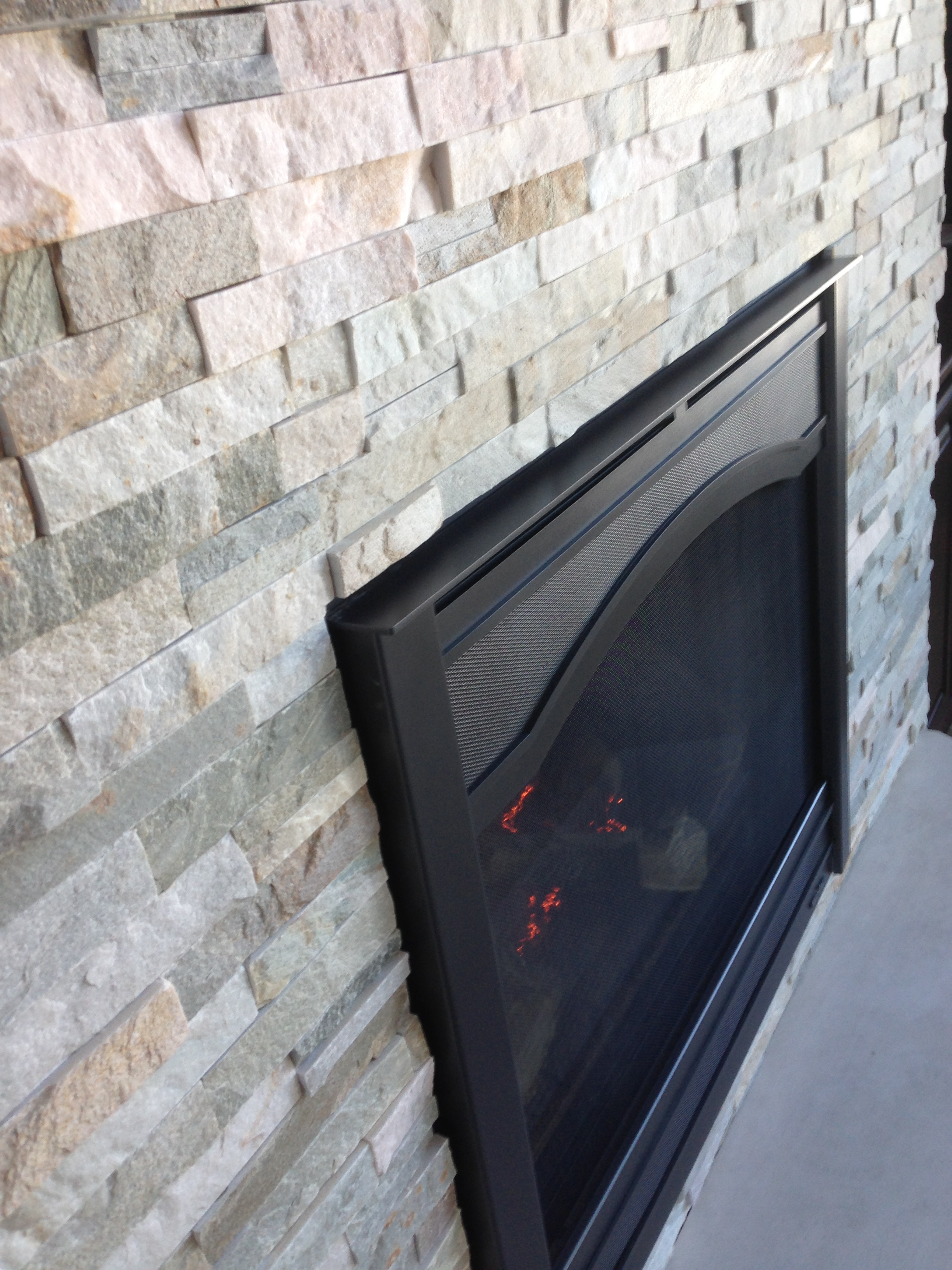 Heat  Glo 6000C Fireplace  Graphite Arcadia Front  Golden Honey Stacked Stone  Gagnon Clay