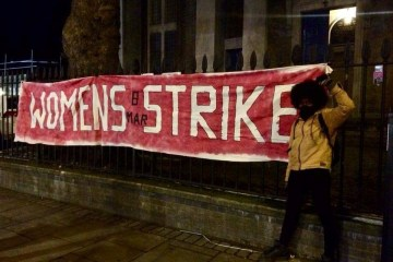 banner says Women's Strike