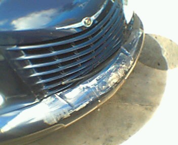 Cracked bumper and grille
