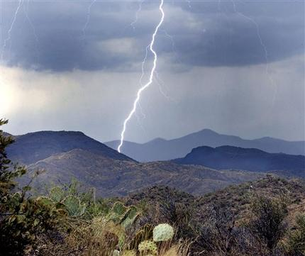 Lightning strikes in the high desert north of Phoenix, Ariz., near the community of Crown King Thursday, June 29, 2006. Lightning is to blame for dozens of new wildfires across the drought-stricken state but rain has helped keep many of the fires from getting out of hand. (AP Photo/Tom Hood)