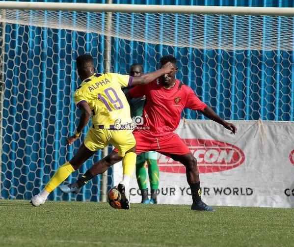 Alpha beat two Myda players before sending a powerful shot past MYDA goalkeeper