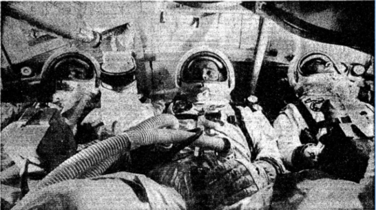 """The astronauts practicing in an Apollo capsule, identical to the one in which they died. From left: Chaffee, White, Grissom."" ""Death . . ."" Sunday Times, 29 Jan. 1967, p. 11. The Sunday Times Digital Archive"