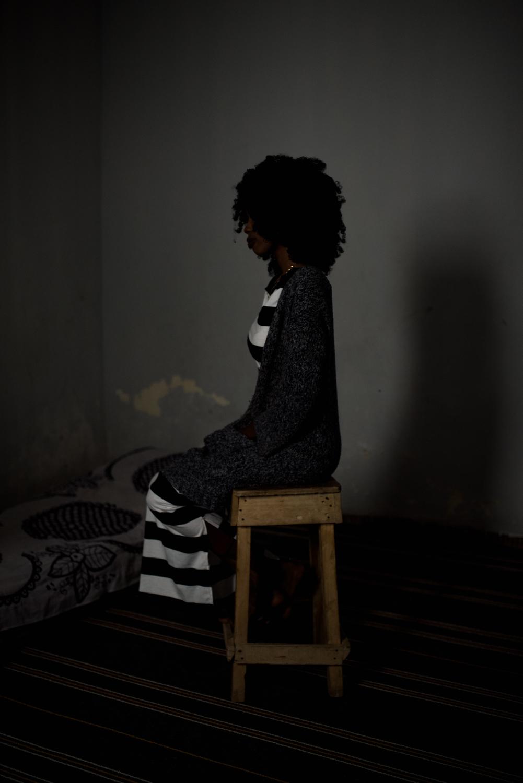 """Portrait of Bambi. Nouakchott-Mauritania.Bambi, 22, is a lesbian. After she came out she lost almost all of her girlfriends. In 2011 her father and uncle arrange the marriage between her and her cousin, since she is under too much pressure.""""My family is waiting for my cousin to finish his studies so they can marry me...one day he will come home and I will have to leave with him, and if I don't, my father threatens to quit my mother. Bambi, 22 ans, est lesbienne. Après son coming out elle a perdu la quasi totalité de ses copines. En 2011 son père et son oncle arrange le mariage entre elle et son cousin, depuis elle subit trop de pression. «Ma famille attend que mon cousin finisse ses études pour pouvoir venir m'épouser…un jour il va venir à la maison et je serai obligée de partir avec lui, et si je ne le fais pas, mon père me menace de quitter ma mère.»"""