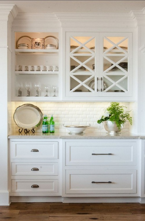 Some beautiful kitchens featuring subway tiles.