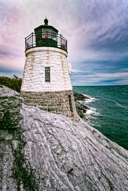 """James Correia Castle Hill Lighthouse Photograph on canvas 20"""" x 30"""" $235.00 Castle Hill Lighthouse, located on Narragansett Bay in Newport, Rhode Island at the end of the historic Ocean Drive. It is an active navigation aid for vessels entering the East Passage, between Conanicut Island and Aduidneck Island. The lighthouse was completed in 1890."""
