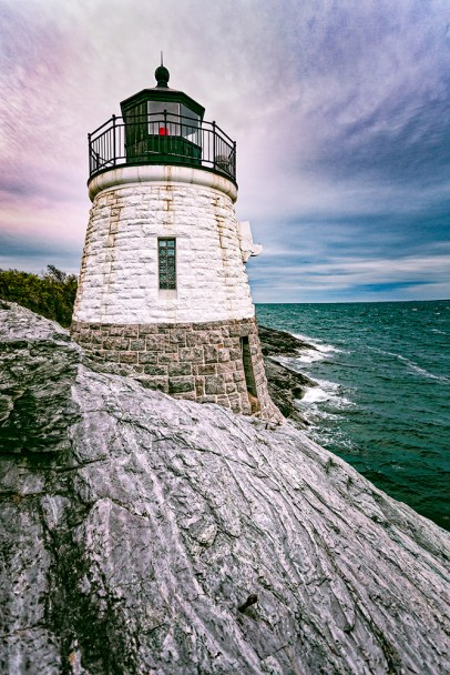 """Castle Hill Lighthouse Photograph on canvas 20"""" x 30"""" $235.00 Castle Hill Lighthouse, located on Narragansett Bay in Newport, Rhode Island at the end of the historic Ocean Drive. It is an active navigation aid for vessels entering the East Passage, between Conanicut Island and Aduidneck Island. The lighthouse was completed in 1890."""