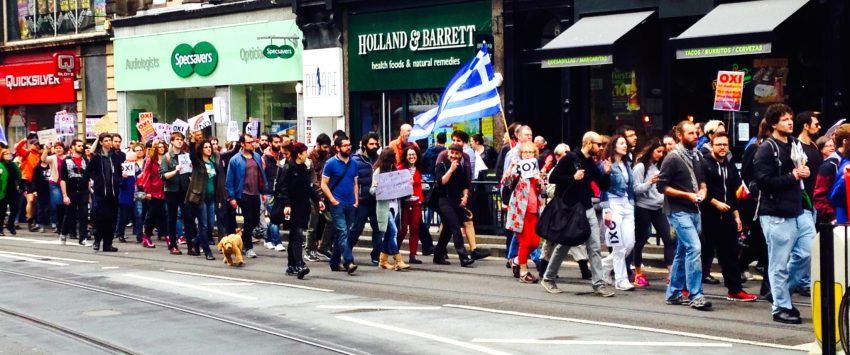 Anti austerity demonstrators march along Princess Street