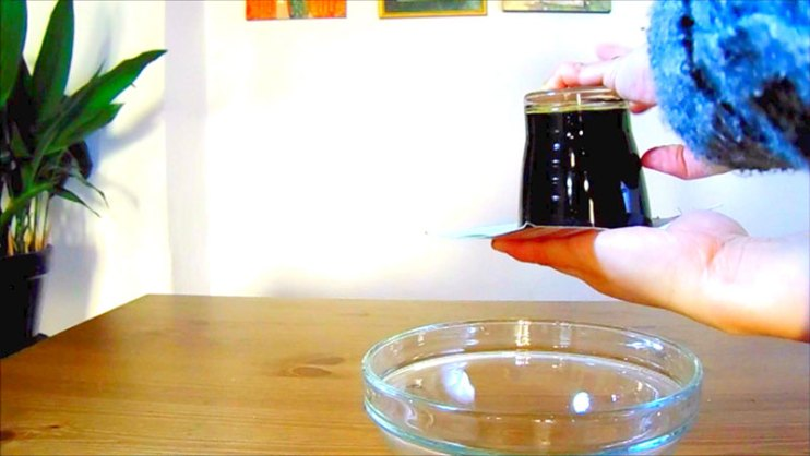 Step 3: In this step, we flip the cup or glass. Make sure you have the glass in the middle of the card.