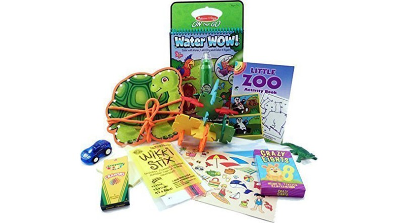 A collection of different activities for toddlers from coloring to yarn work.