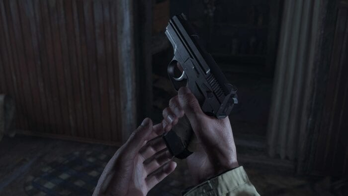 Loading a gun in first person, Resident Evil Village