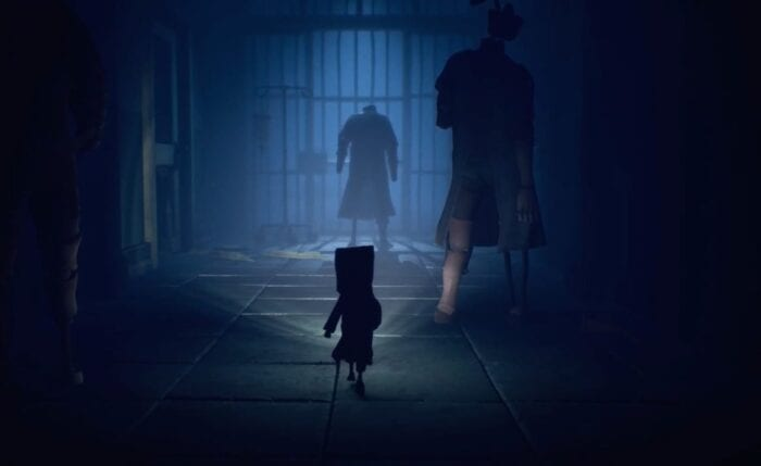 Mono with a torch near some enemies in Little Nightmares 2