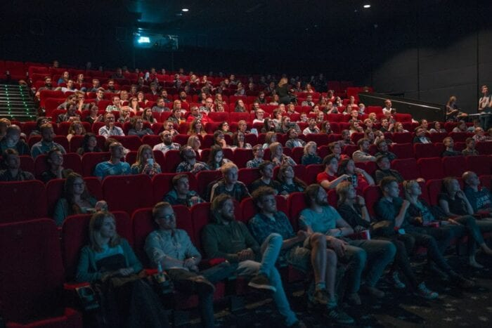 Stock photo of people at the cinema