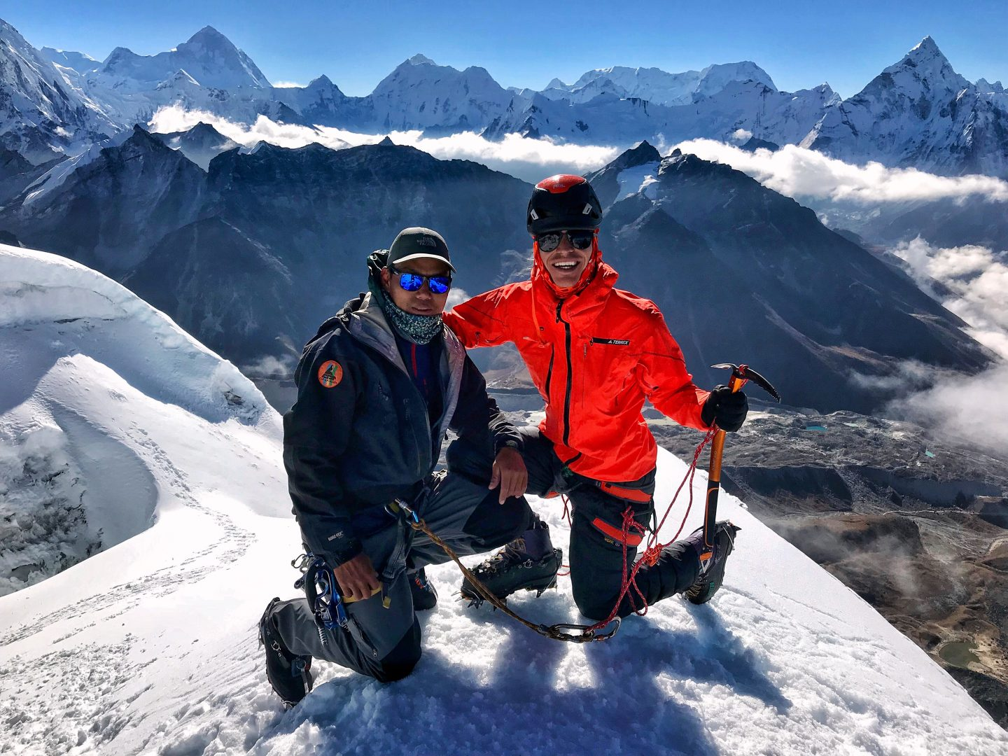 hight resolution of marcel and his guide domi on top of the mount everest smiling into the camera
