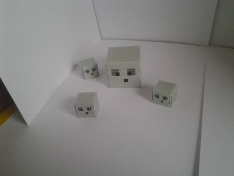 1 large slime papercraft and 3 small cutout modles