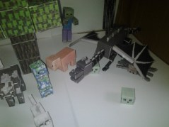 This is a little Minecraft papercraft scene featuring the Enderdragon, a paper wolf, charged creeper, slimes, zombies and more animals