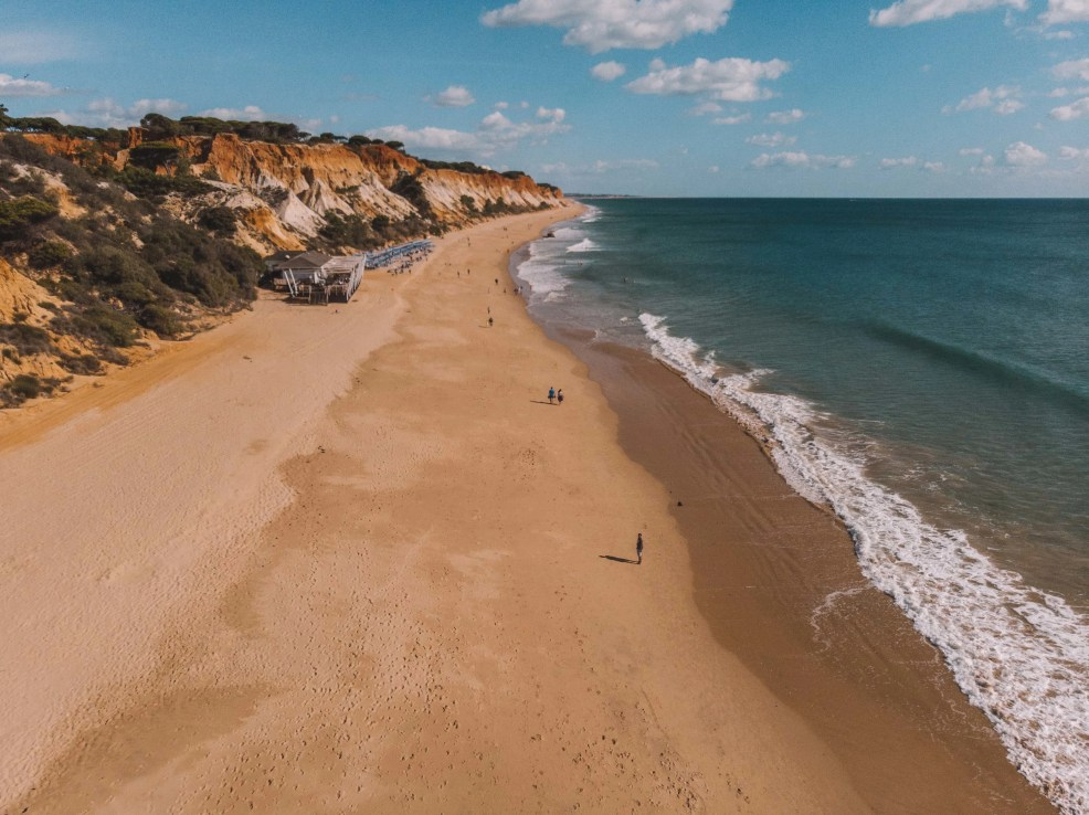 How to get to Albufeira from Lisbon, beaches in   Albufeira, where to stay in Albufeira, best time to   viit Albufeira, where to eat in Albufeira, how to get to Albufeira from Faro airport, Olhos de Agua