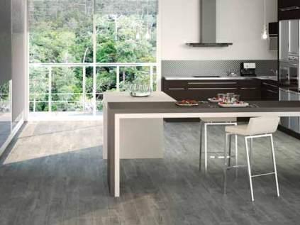 Cocina en tonos gris, madera y antracita.