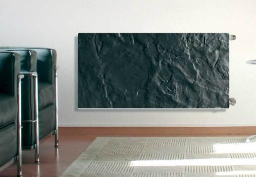 Catálogo CALOR de Grup Gamma donde aparece un radiador de pared que imita piedra negra.