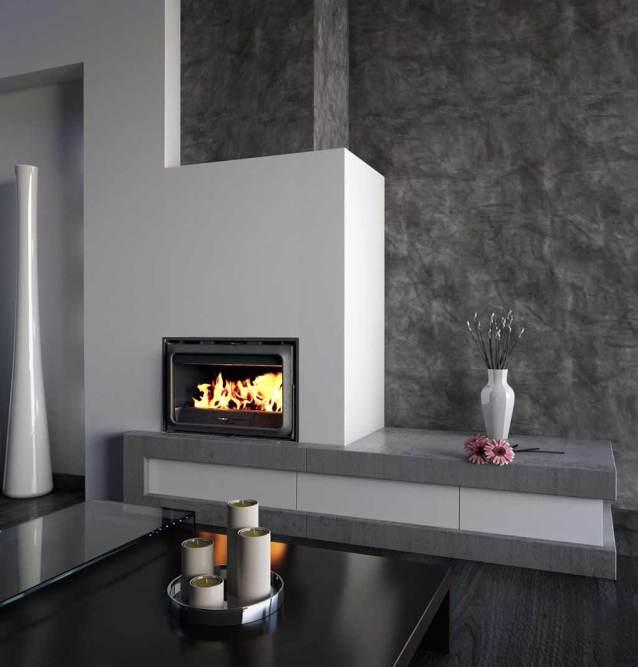 Chimeneas y estufas donde aparece la chimenea IF800 de Lacuzna en un salón decorado en tonos blancos y grises.