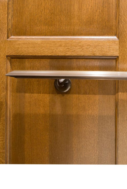 Veneer Elevator Cab Interior and Extruded Oxidized Bronze Handrail with Custom Stand-offs