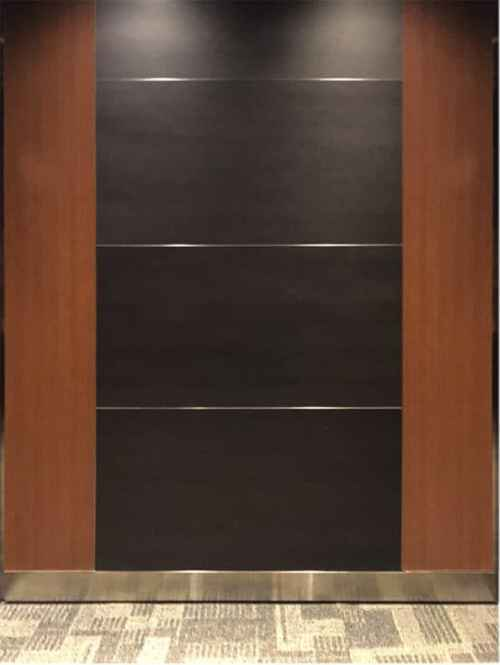 Elevator Modernization at 12701 Whitewater, Minnetonka. Laminate vertical accent panels and black horizontal center panels