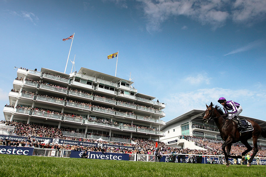 An image of horses racing in the Epsom Derby - book a chauffeur to this event from GandT Executive