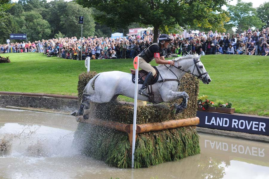 An image of a horse competing at the Burghley Horse Trials - book a chauffeur to this event from GandT Executive