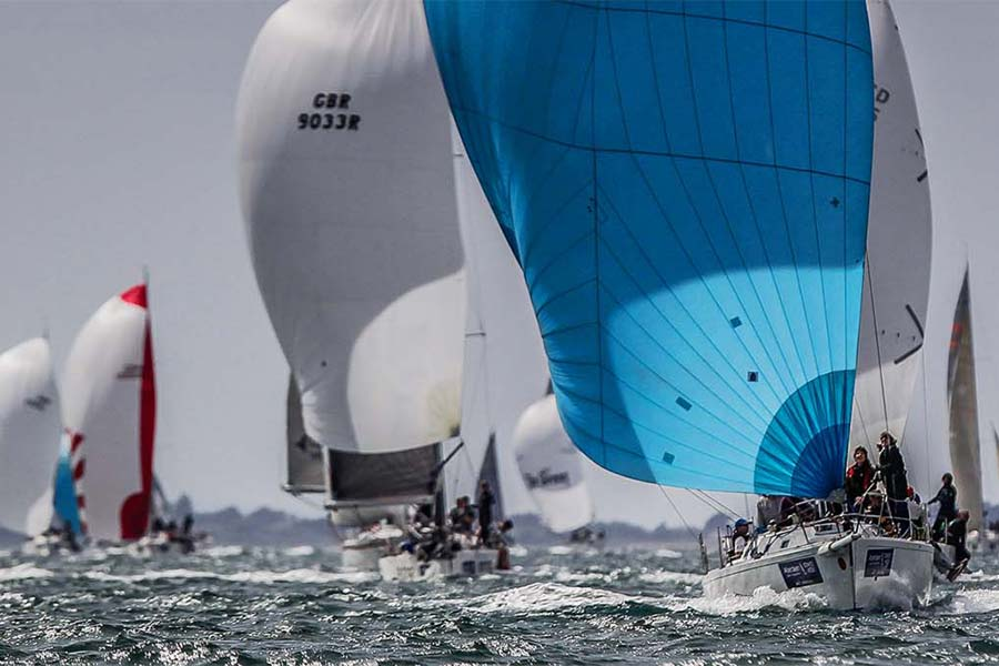 An image of yachts racing in the Cowes International Yachting Week - book a chauffeur to this event from GandT Executive