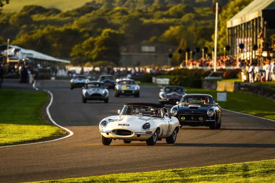 An image of vintage cars racing at the Goodwood Revival - book a chauffeur to this event from GandT Executive