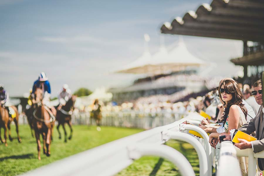 An image of horses racing at the Glorious Goodwood Festival - book a chauffeur to this event from GandT Executive