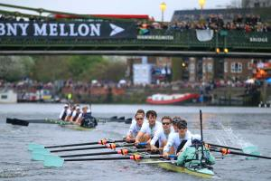 An image of rowers competing in the Oxford Cambridge boat race - book a chauffeur to this event from GandT Executive