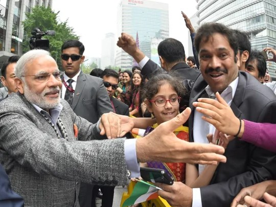 Indian Prime Minister Narendra Modi, left, is greeted