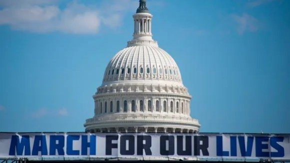 The March For Our Lives stage sign is seen near the
