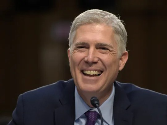 Supreme Court Justice nominee Neil Gorsuch smiles as