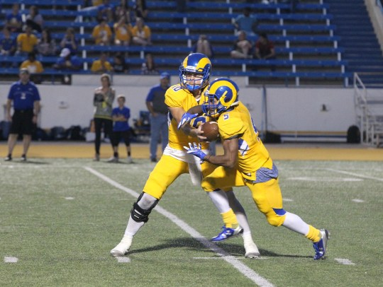 Angelo State University senior quarterback Jake Faber handed the ball to fellow senior Josh Stevens during a 51-3 win against A&M West Texas on Senior Day at LeGrand Stadium at 1st Community Credit Union Field. Faber and Stevens are among the 13 seniors who made their last home appearance on Saturday, November 4, 2017.
