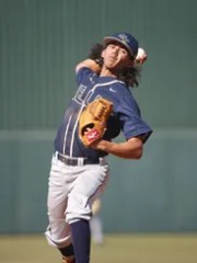Raymond S. Kellis' Adrian Salazar (7) throws against