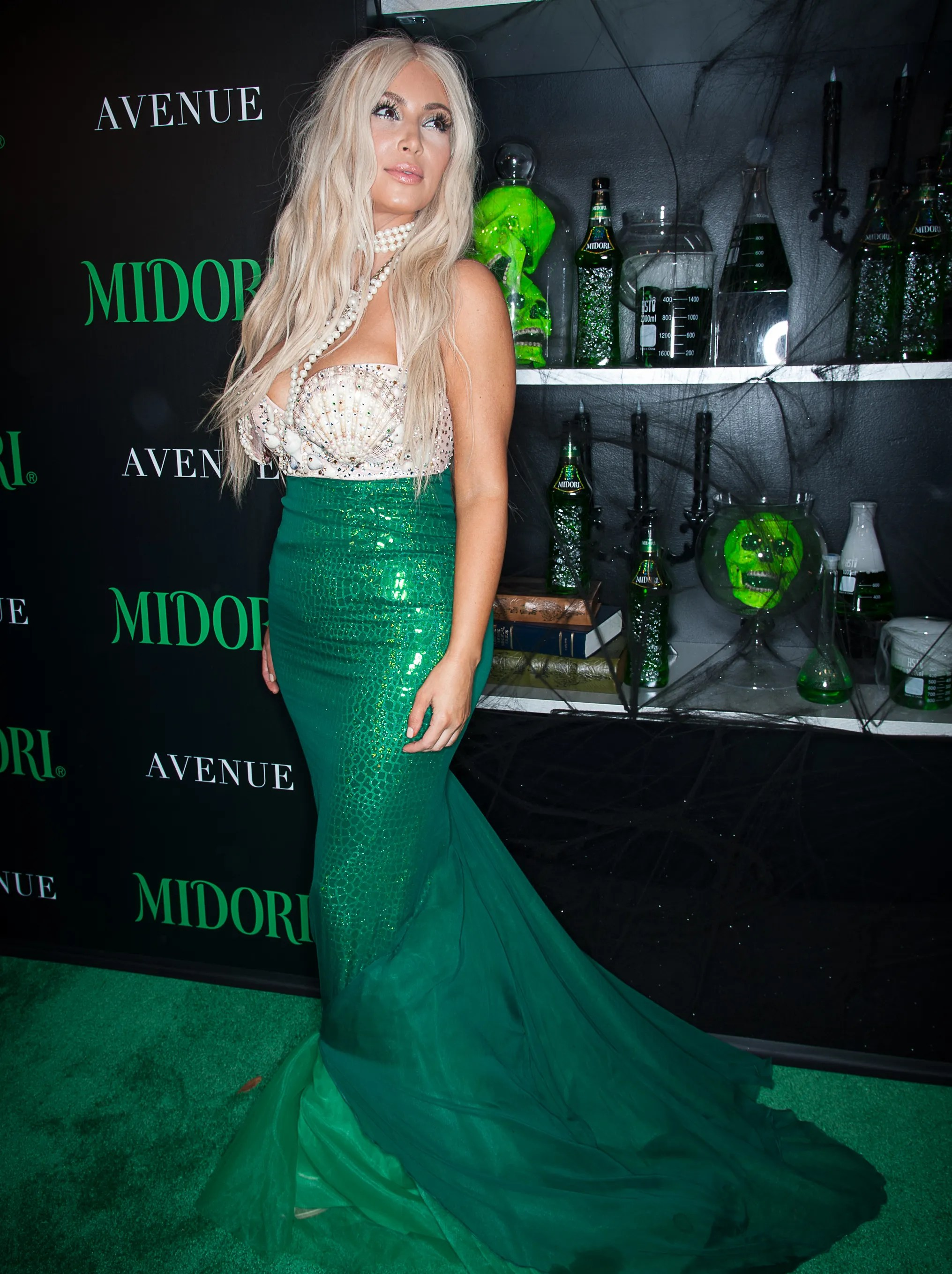 That's a whole lotta emerald, Kim. Kardashian does her employer proud at the Midori Green Halloween Party on Oct. 27, 2012 in New York City.