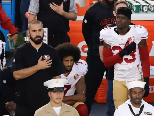 San Francisco 49ers quarterback Colin Kaepernick, middle,