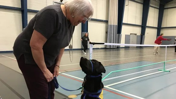 Debra Everington and CCI pup Chance at a recent pickleball