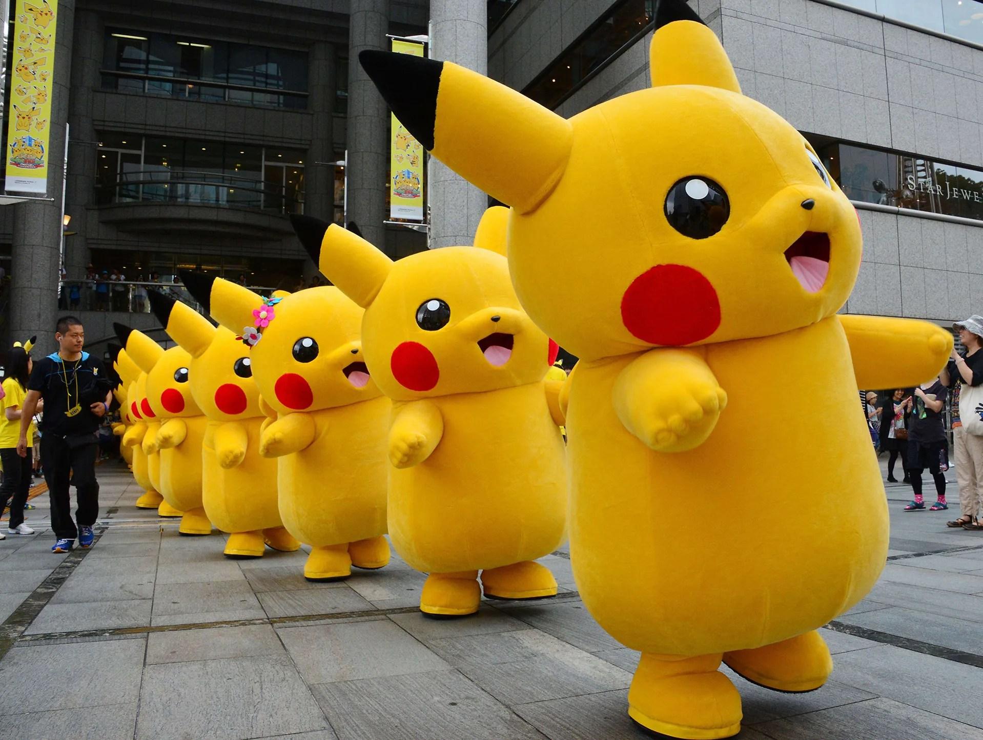 Pikachu characters from the Nintendo video game Pokemon parade at the Landmark Plaza shopping mall on Aug. 14 in Yokohama, Japan.