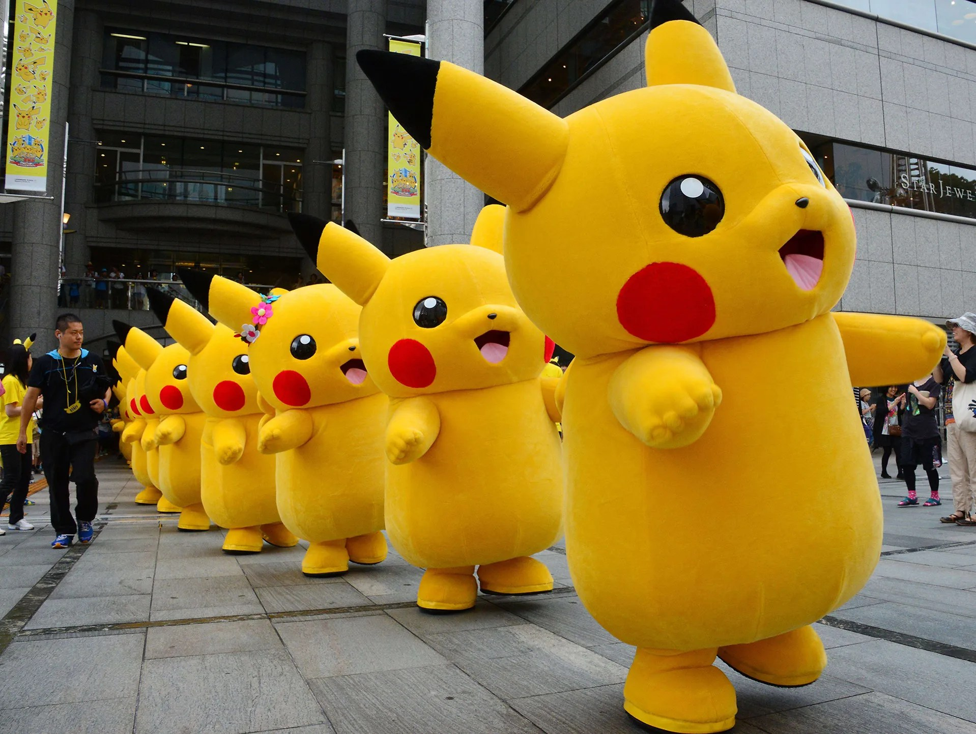Pikachu characters from the Nintendo video game Pokemon parade at the Landmark Plaza shopping mall on Aug. 14 in Yokohama, Japan.