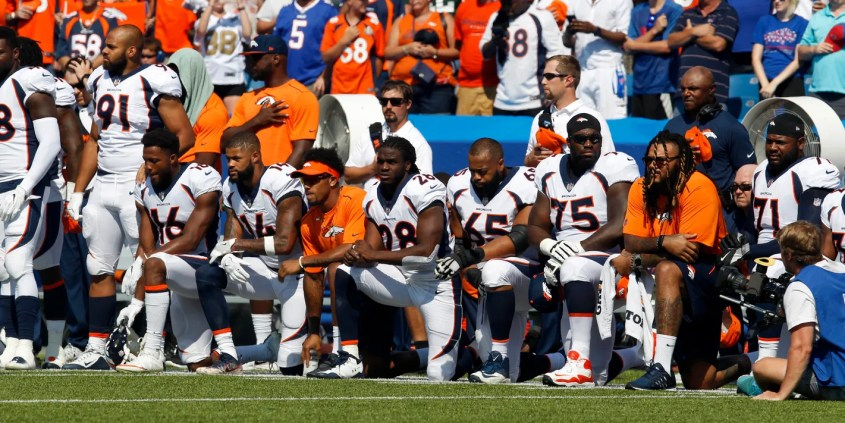 Denver Broncos kneel in protest during the national anthem before their  game against the Buffalo Bills. (Photo  Timothy T. Ludwig beba209b7