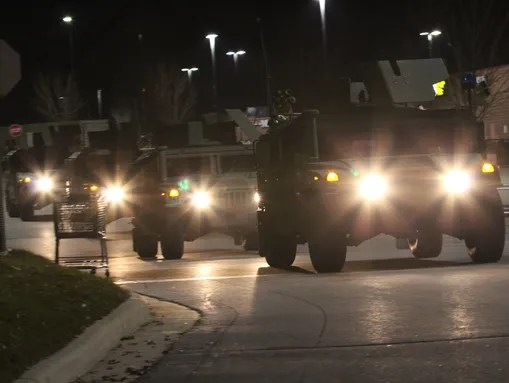 National Guard HUMVEEs pulling into the Ferguson staging
