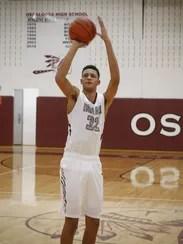 Oskaloosa freshman Xavier Foster, 14, takes a jump