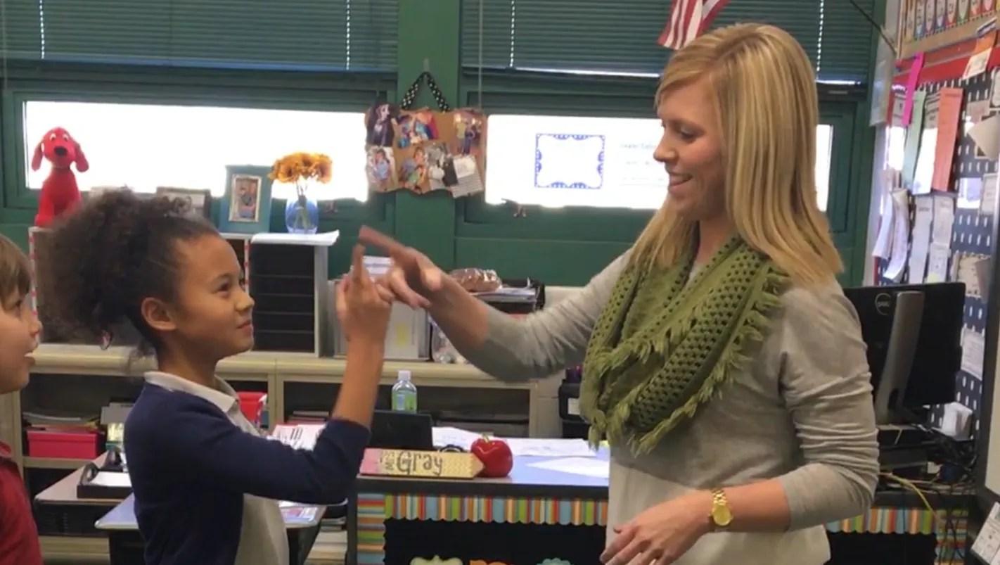Third Grade Teacher Learns Handshakes For Each Student