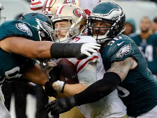Philadelphia Eagles' Destiny Vaeao (97) and Chris Long (56) take down San Francisco 49ers' C.J. Beathard during the second half of an NFL football game, Sunday, Oct. 29, 2017, in Philadelphia. (AP Photo/Chris Szagola)