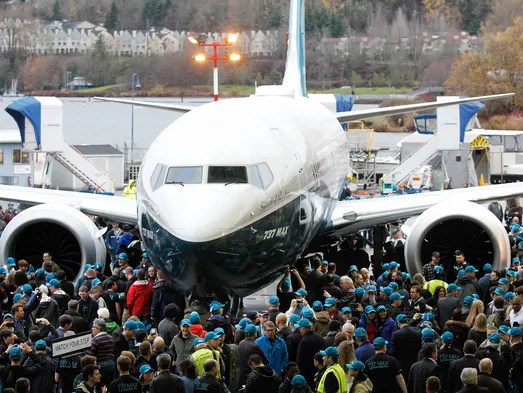 Employees gather for a closer view as Boeing rolls