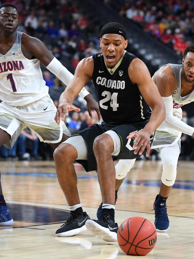 Colorado Buffaloes guard George King (24) loses the ball between Arizona Wildcats guard Rawle Alkins (1) and forward Ira Lee (11) during a Pac-12 Tournament quarterfinals match at T-Mobile Arena.