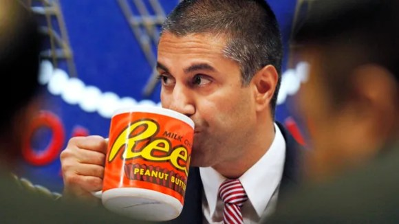 Federal Communications Commission (FCC) Chairman Ajit Pai takes a drink from a mug during an FCC meeting where the FCC voted to repeal net neutrality, Dec. 14, 2017, in Washington.