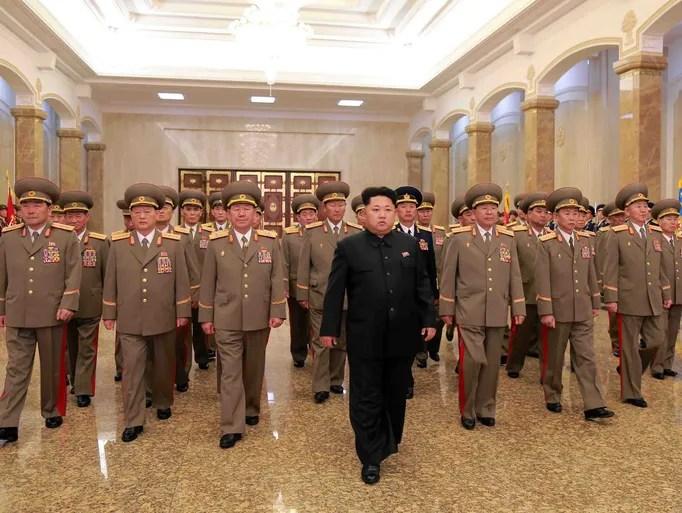 North Korean leader Kim Jong-Un, center, visits the